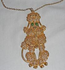 Large vintage brass poodle pendant, pendulum feet and tail