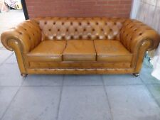 A Large Tanny/Gold Leather Chesterfield Three Seater Sofa Settee