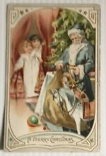 "Tucks ""A Merry Christmas"" Blue Suited - 2 Children - Toys Embossed Postcard"