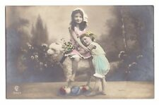 Photo Pc cute girls on sheep with Easter eggs tinted Gl & Co P0358