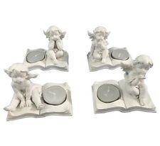 Nuevo conjunto de 4 Ángel Querubín tumbado en Libro blanco de vela ligera del té titulares che104