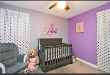 baby changing table with drawers and crib.