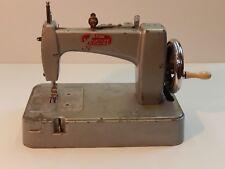 VINTAGE ESSEX MINIATURE TOY SEWING MACHINE.