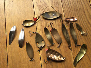 A GROUP OF OLD BRASS FISHING LURES.