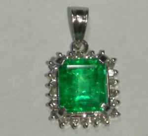 Solid platinum natural emerald and diamond pendant 2.12 grams