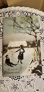 ANTIQUE HTL HOLD TO LIGHT A JOLLY CHRISTMAS postcard children skating snowman