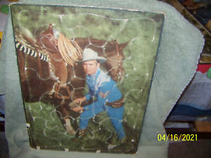 lot of [2} vintage  1940's childern's tray puzzles   {gene autry}