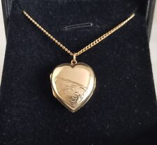 A 9ct Yellow Gold locket. Suspended on a 9ct gold chain.By Fred Manshaw Ltd.