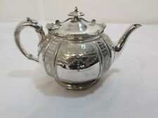 A Victorian Silver Plated Tea Pot With Engraved Patterns.j.dixon.sheffield.