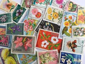 30 used exotic flower themed.Very pretty.Off paper. All different