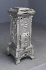 Poêle à bois en fonte époque Art nouveaux aux cigognes vers 1900
