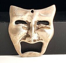 Vintage  silver embossed  Theater Mask.