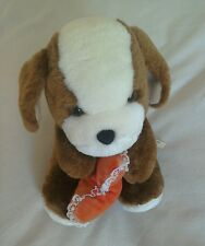 Dog soft toy holding a heart