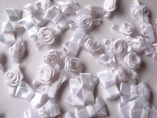 25 SATIN WHITE BOWS 20MM & 25 MEDIUM SIZED WHITE RIBBON ROSES 12MM WIDE
