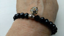 LOVELY FACETED BLACK BEAD ELASTICATED BRACELET WITH SILVER TONE SPARKLY BEAD