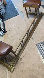 Fireplace club fender brass leather seat, restoration/polish needed.