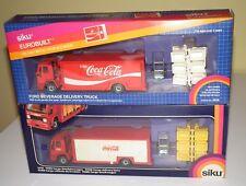 Two 1970's SIKU Eurobuilt Coca-Cola delivery trucks in original boxes
