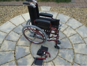 Slim elderly persons wheelchair. Red 14 inch seat width.