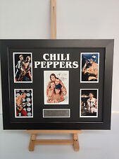 PROFESSIONALLY FRAMED, SIGNED RED HOT CHILI PEPPERS PHOTO COLLAGE WITH PLAQUE.