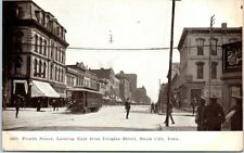 IOWA Postcard Sioux City IA Fourth Street East View Schlitz Sign Trolly Stores