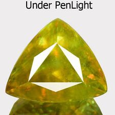 6.07 cts Rare Natural Trillion-cut Flashing Green->Yellow VS Sphene (Brazil)