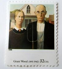 Art postage stamp Grant Wood American Gothic rural couple with pitchfork