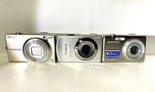 Canon Power Shot SD880 IS Digital Elph 10 Mega Pixals FREE Nikon/Olympus Cameras