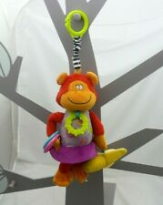 Taf Toys hochet activité à suspendre singe orange mauve velours tissu