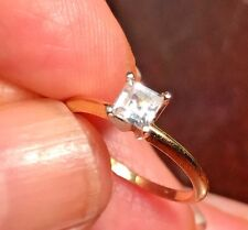 Engagement ring square emerald cut diamond .39 points set in 14k yellow gold