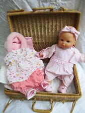 poupée bébé do Corolle avec tenues et malle