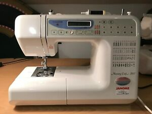 Janome Memory Craft 3500 with hard case and instruction booklet