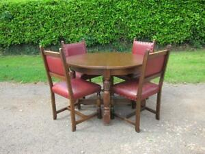 Extending Dark Oak Gothic Round to Oval Dining Table & 4 Red Leather Oak Chairs