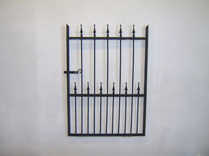 4 ft tall wrought iron  garden / side gate very strong hangs on the right !