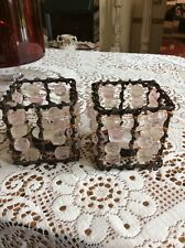 A PAIR OF BROWN METAL TEA LIGHT HOLDERS WITH PINK AND CLEAR JEWELS
