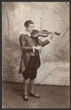 Young Violin Player. Young Man in Velvet Knockerbockers & Silk Long-Tail Jacket