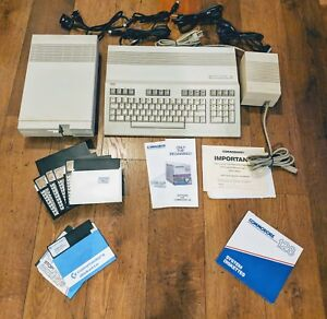 Commodore 128 Computer W Disk Drive, Power Adapter, Diskettes, Cords And Manuals