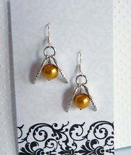Golden Snitch Wings with Golden Pearl Ball Earrings for a Harry Potter Fan