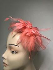 Lovely Coral coloured  Feather Fascinator