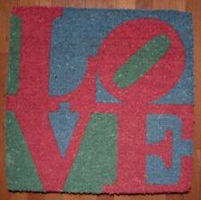 "Robert Indiana's Coconut Husk Love Mat by John Gilbert Measures 24"" X 24"" inches"