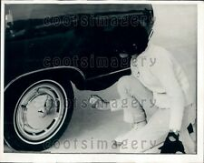 1968 Zurich Switzerland Woman Sprays Fluid Snow Chain on Tire Press Photo
