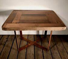 Tavolo da caffè  in legno vintage, resina trasparente e base in ferro ossidato.