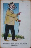 1908 Postcard - Man Wearing Dog Muzzle & Walking w/Cane