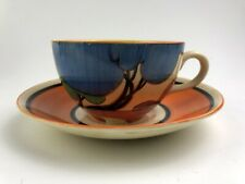 Clarice Cliff BLUE AUTUMN pattern, globe shape tea cup and saucer. C1931.