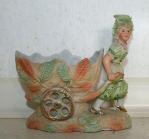 Victorian bisque girl pulling wheelbarrow, Spill vase. Hand-painted. Ex. Cond.