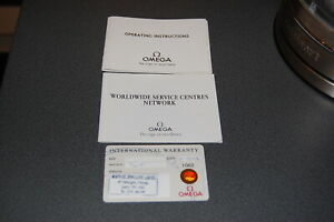 Omega warranty card and booklets.