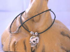 Silver metal alloy flat skull shaped pendant on black waxed cotton cord necklace