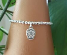 silver plated stretchy stacking bracelet with candy skull charm