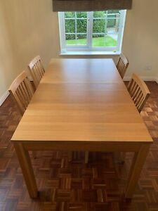 Extending 1.75m-2.60m. Oak Colour Ikea dining table + 4 chairs - Seats 4 To 12.
