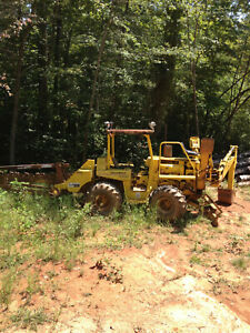 Ditch Witch trencher with backhoe and scrape blade