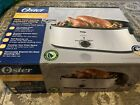 Oster 22qt Roaster Oven with Self-Basting Lid (BRAND NEW IN BOX) photo
